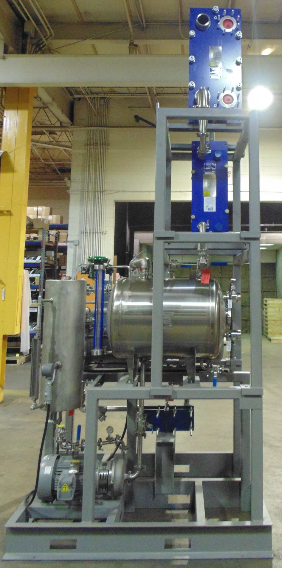 liquid ring vacuum system utilizing plate and frame heat exchangers for vacuum flash cooling